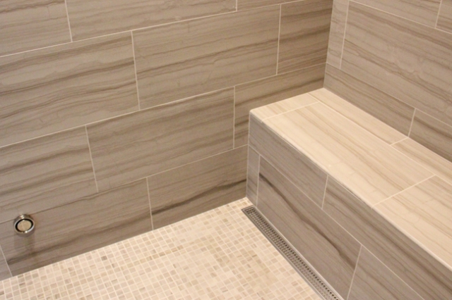 Shower seat in custom built luxury home by Martin Bros. Contracting, Inc.
